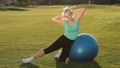 Sporty fit lady doing side crunches on ball 31346001