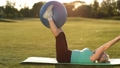 Adult woman making exercise with fitball in park 31346036