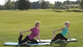 Sporty women performing yoga exercises outdoors 31346060