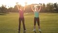 Charming ladies working out with dumbbells in park 31346081