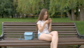 Young beautiful white girl is sitting on a park 31626474