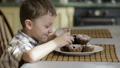 Little boy eating cake at home 32164962