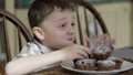 Little boy eating cake at home 32164963