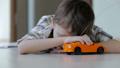 sad little boy lying on the floor at home 32164989