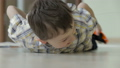 Happy little boy playing with toy car 32164991