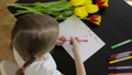Happy little girl makes a holiday card for his mom 32165050