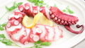 Pouring Sauce on to Octopus Carpaccio  32595171