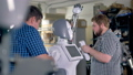 Engineers attach arms to a robotic body frame.  32631814