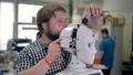 A technician uncovers a robots head shell. 32644405