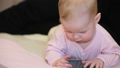 Baby with cell phone 32652070