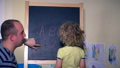 Man and little girl child learning numbers and 32897797