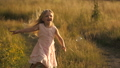 Cute little girl running at field 32923026