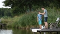 Hipster dad and boy enjoying fishing at the pond 33016545