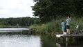 Fisherman with spinning rod catching fish on lake 33016565