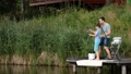 Father and son stretching rod with fish on hook 33016574