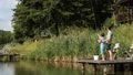 Cute teenager learning to fish on lake in summer 33016575