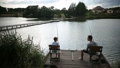 Father and son spending leisure fishing at pond 33016579