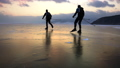 Two men are skating on the ice of frozen Lake 33033028