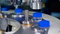 A macro shot of metal cappers working at milk 33156221