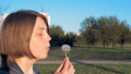 Young girl blows off the dandelion - slowmo 180 33159894