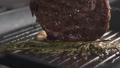 Slide slow motion shot of cooking rib eye steak 33460974