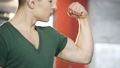 Athletic male friends demonstrating strong biceps,  33464467