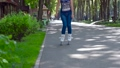 Girl rollerblading in the city park 33566889