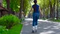 Girl rollerblading in the city park 33566900