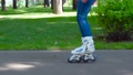 Girl rollerblading in the city park 33566904