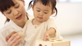 Mother and daughter (playing blocks) 33667710