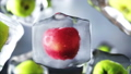 Apples rotate in ice cubes. Food and broadcast 33668934