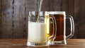 Pouring Beer In The Glass (Mug) 33877754