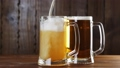 Pouring Beer In The Glass (Mug) 33877755