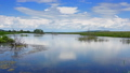 Clouds are reflected in smooth water of lake 33937367