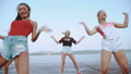 Pretty women dancing synchronously on the beach 33958163