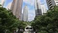 Megapolis東京新宿摩天大樓生動的綠色藍天和雲延時縮小 34225440