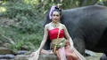 Asian woman with elephant in creek ,Chiang mai Tha 34495877