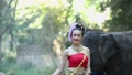 Asian woman with elephant in creek ,Chiang mai Tha 34495879