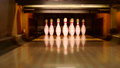 Bowling ball knocking pins on the bowling lane 35086349