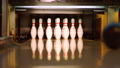 Black bowling ball knocking pins on the bowling 35086350