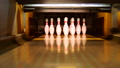 Bowling ball knocking pins on the bowling lane 35086951