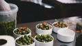 Cooks spread the olives in bowls 35292775