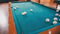 Young guy beats a cue on the ball 35292785