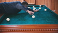 Man rolls the ball into the hole 35292851