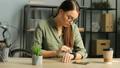 Beautiful brunette woman using smart watch with 35325569