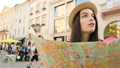 Beautiful young woman with tourist map looking 35325576