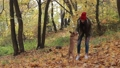 Hipster girl and dog enjoying in autumn park 35352057
