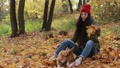 Hipster woman and dog playing with fallen leaves 35352065