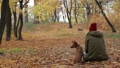 Portrait of woman with her dog in autumn park 35352616