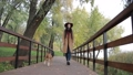 Fashionable woman walking the dog in public park 35352649